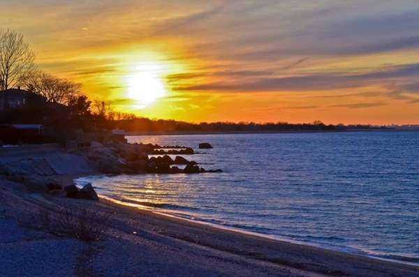 This winter sunset of Bayville's rocky shoreline was