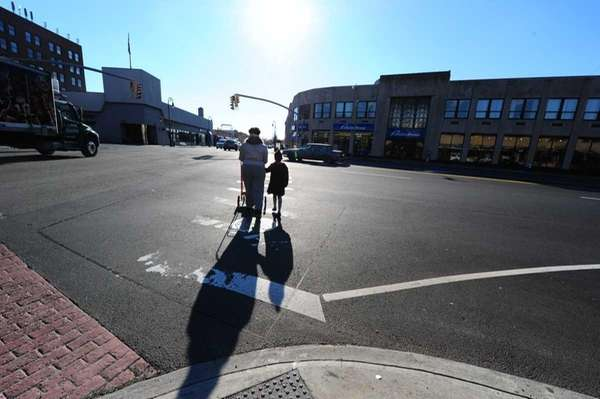 Pedestrians crossing at the intersection of Hempstead Turnpike