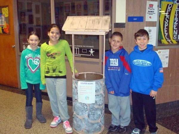 Fifth-graders Brianna Haskins, Nicole Celis, Jarrod Pine and