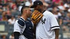 Yankees catcher Gary Sanchez talks to starting pitcher