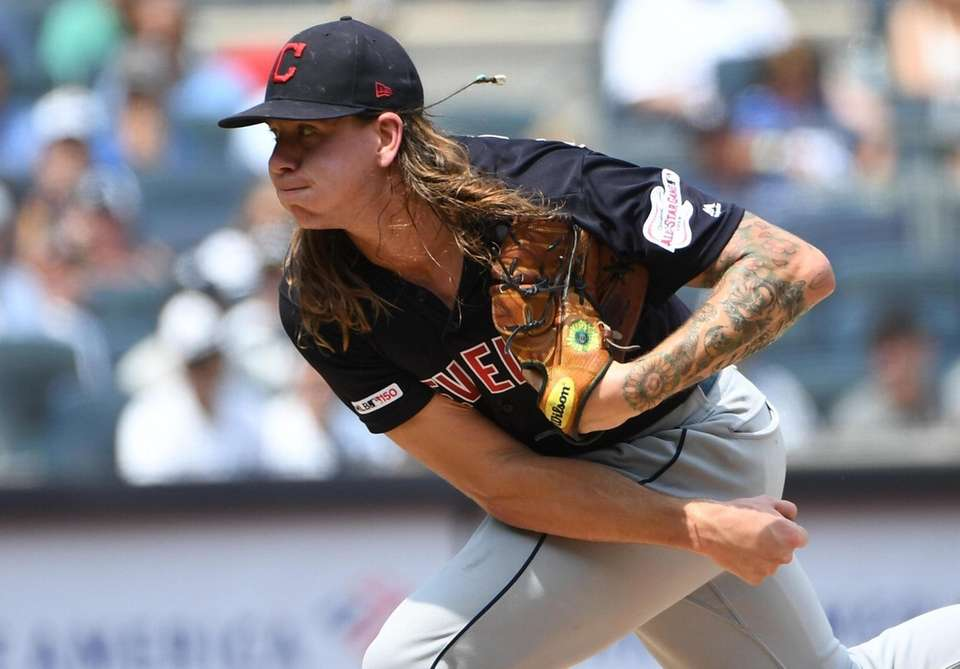 Cleveland Indians starting pitcher Mike Clevinger delivers against