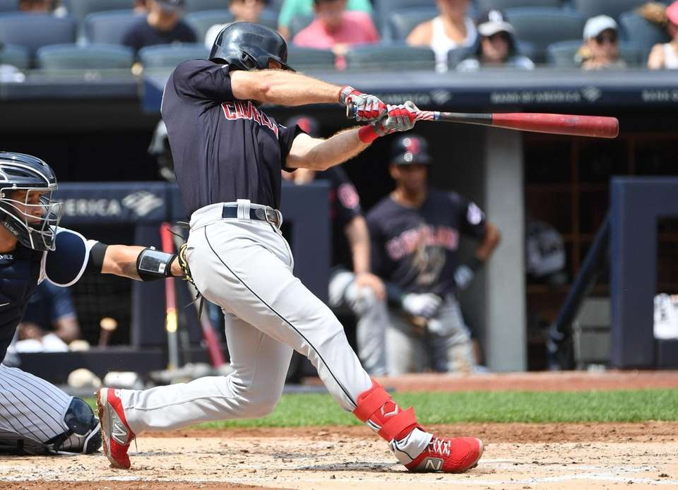Cleveland Indians' Mike Freeman hits a three-run home
