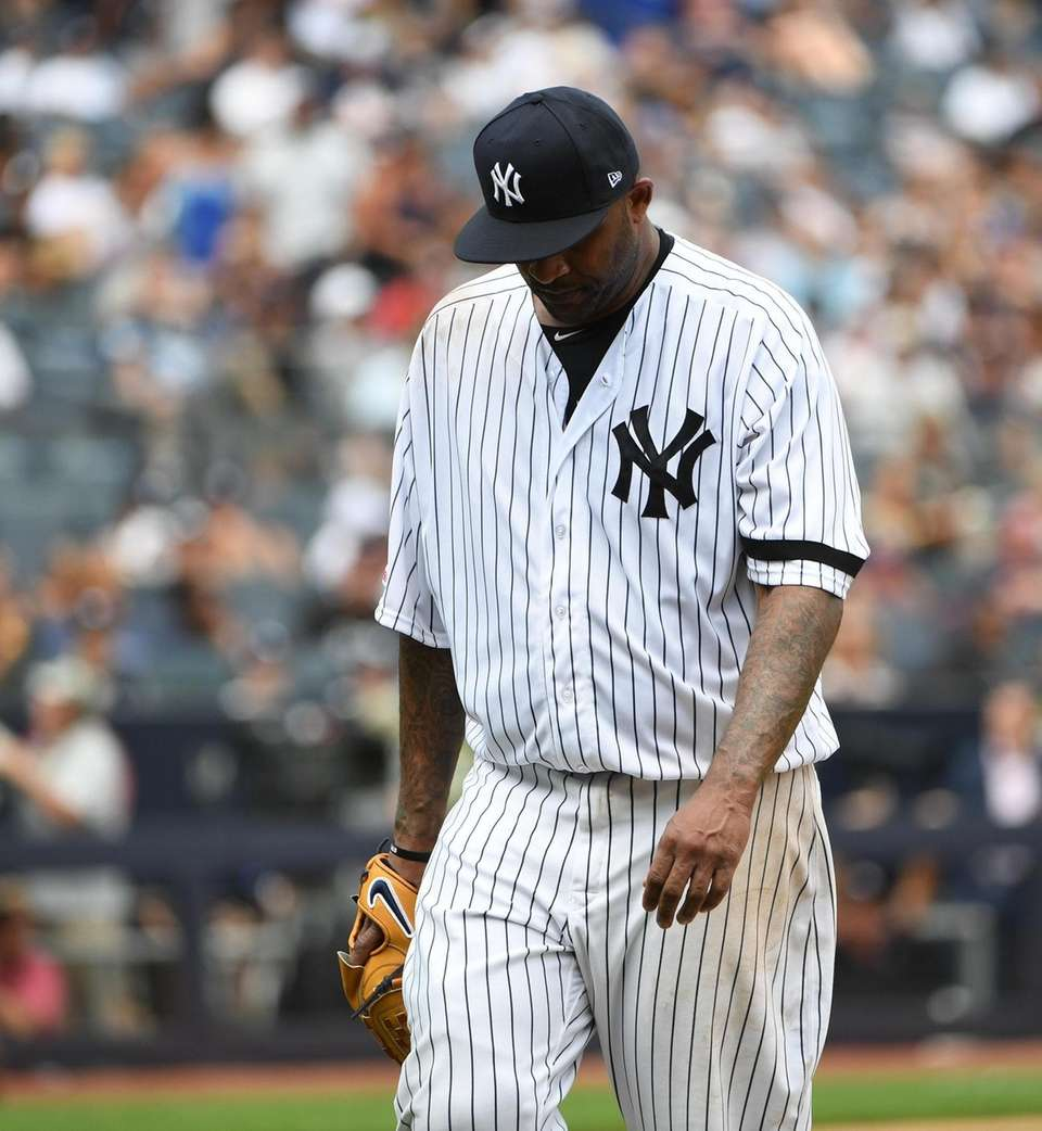 Yankees starting pitcher CC Sabathia walks to the