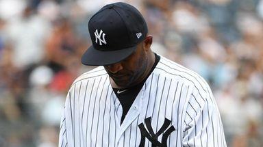 Yankees starting pitcher CC Sabathia walks to the