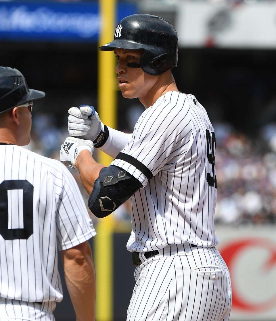 Yankees outfielder Aaron Judge gestures from first base