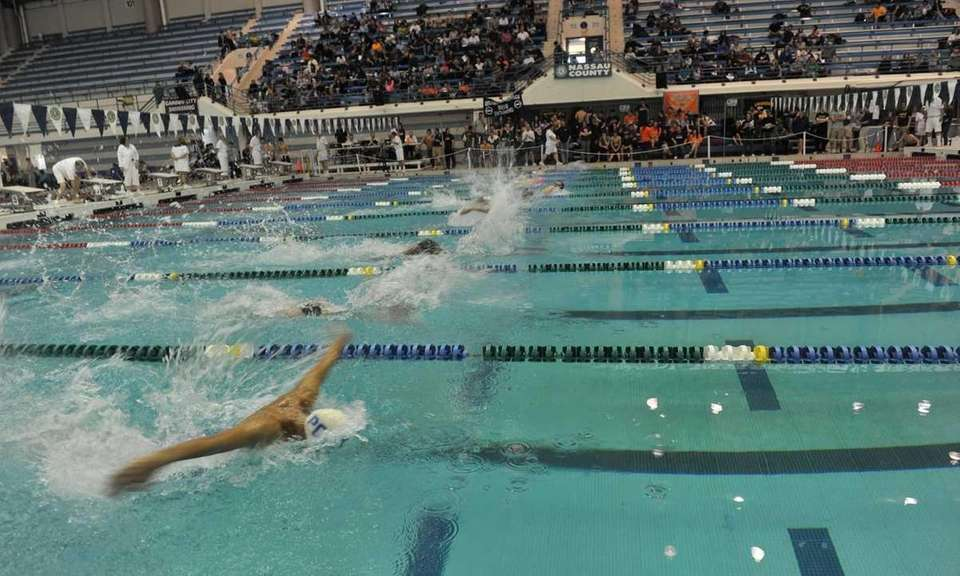 Swimmers participate in the 200-yard freestyle event in