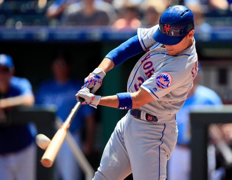 The Mets' Michael Conforto hits a three-run home