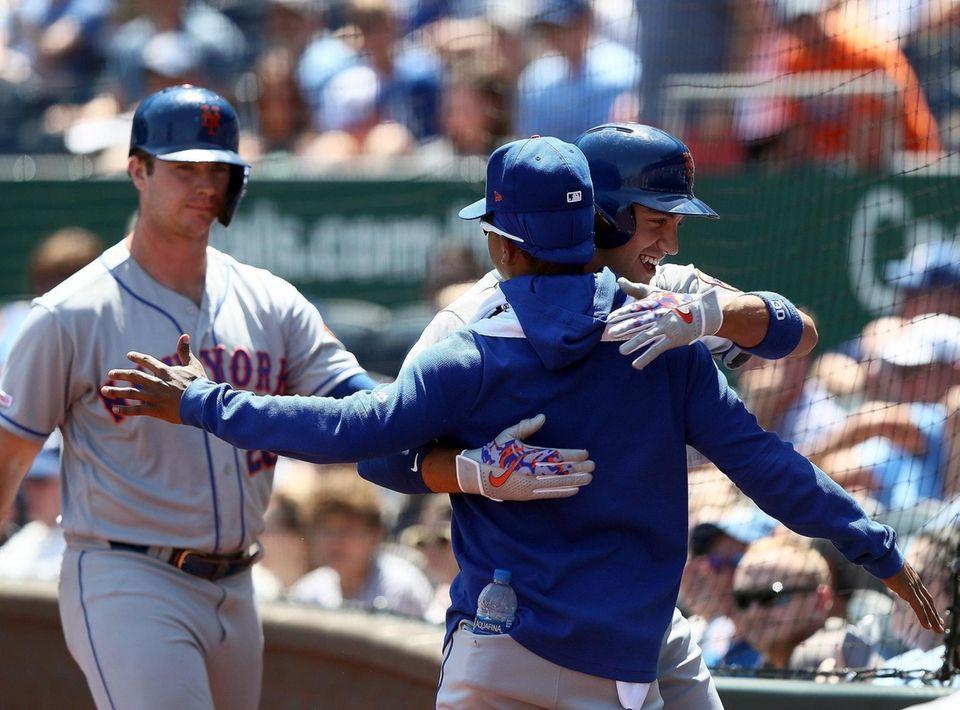 The Mets' Michael Conforto celebrates his home run