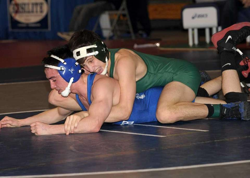A Bellmore JFK player controls Long Beach's Matt