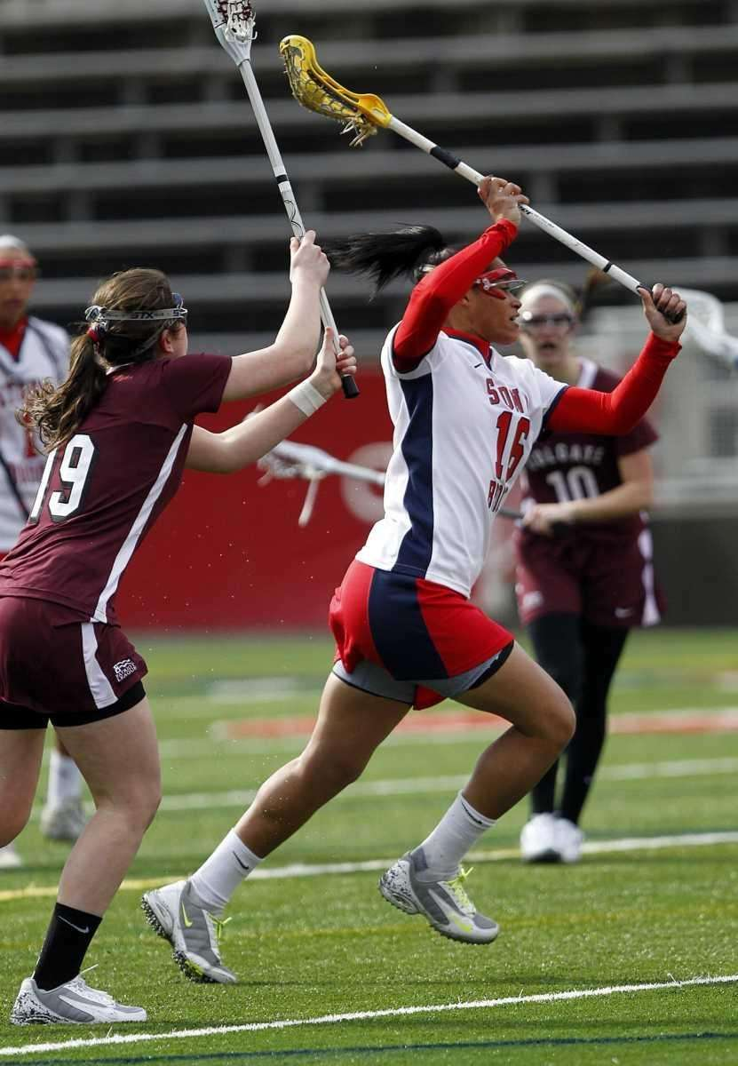 Stony Brook's Demmianne Cook (6 goals) shoots for