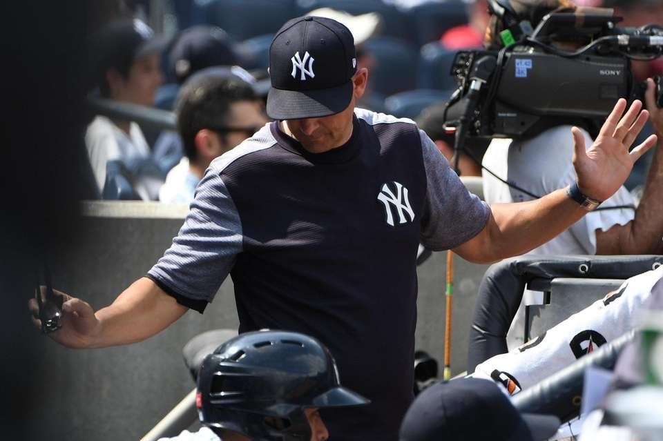 New York Yankees manager Aaron Boone reacts to