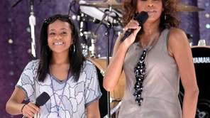 Whitney Houston, right, sings with her daughter, Bobbi