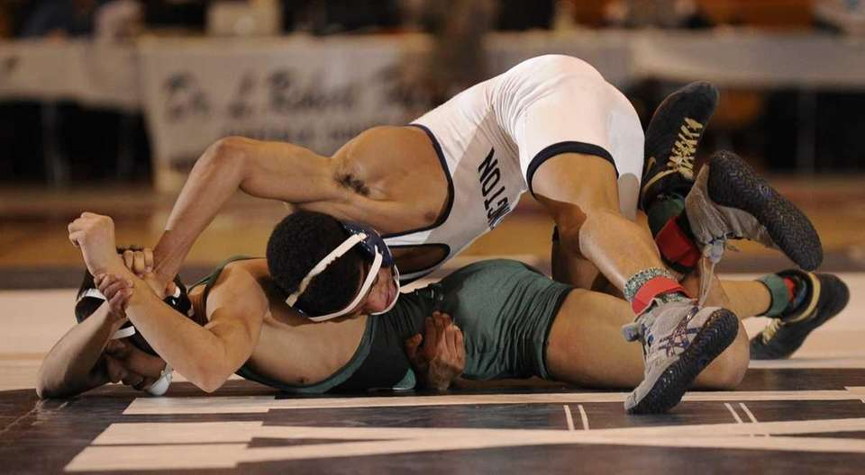 Huntington's Corey Jamison and Brentwood's Eric Orellana wrestle