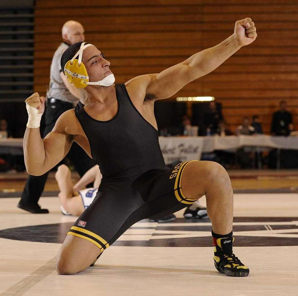 Sachem North's Gio Santiago reacts after he pins