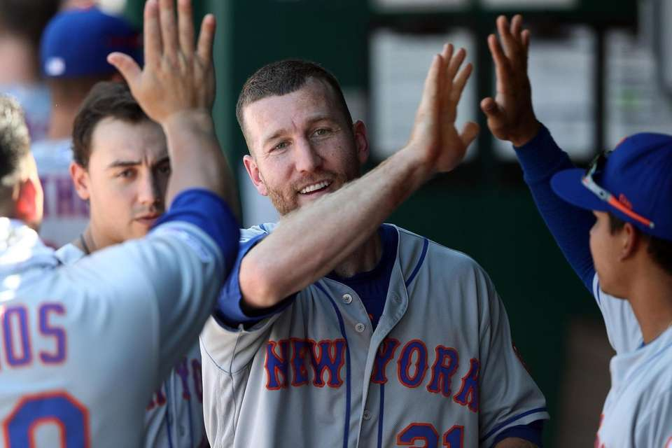 Mets third baseman Todd Frazier is congratulated by