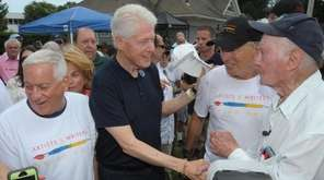 Former President Bill Clinton on Saturday shook hands