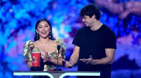 Lana Condor and Noah Centineo speak onstage during