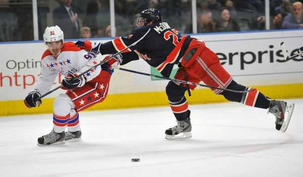 Ryan McDonagh of the Rangers pushes Marcus Johansson