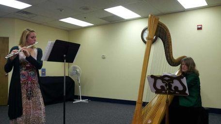 Flautist Karin Marcello and harpist Karen Lindquist perform