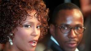In this file photo, Whitney Houston looks over