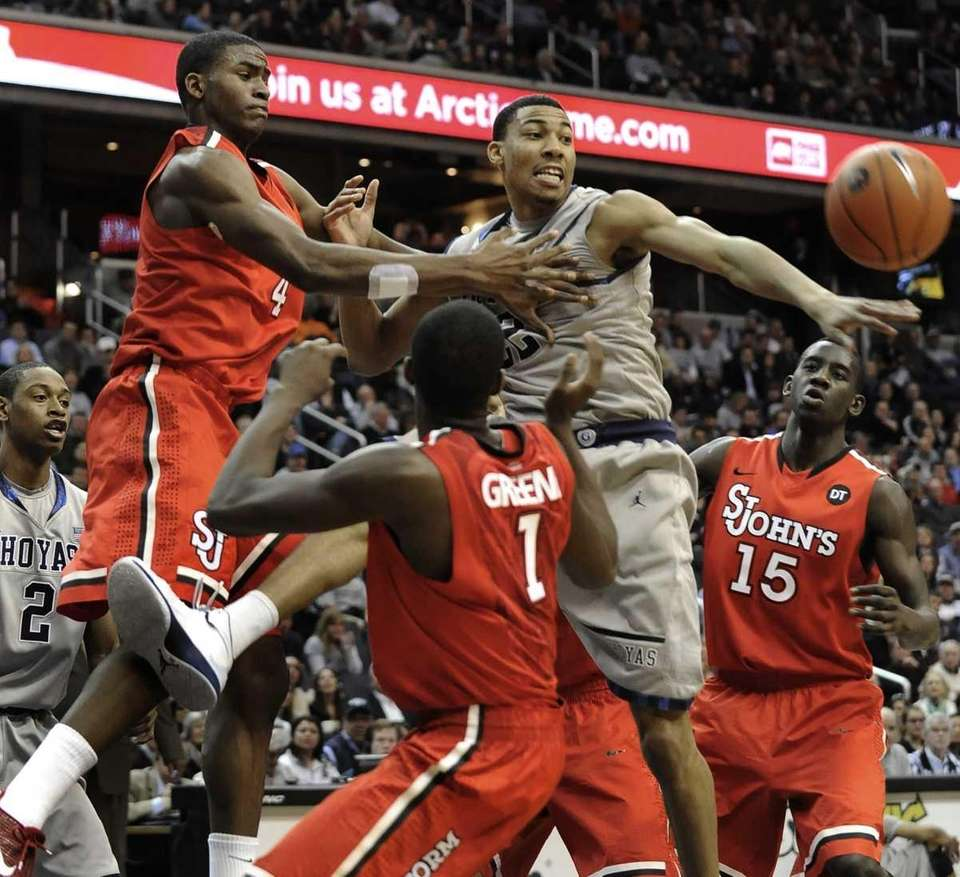 The ball bounces away as Georgetown's Otto Porter,