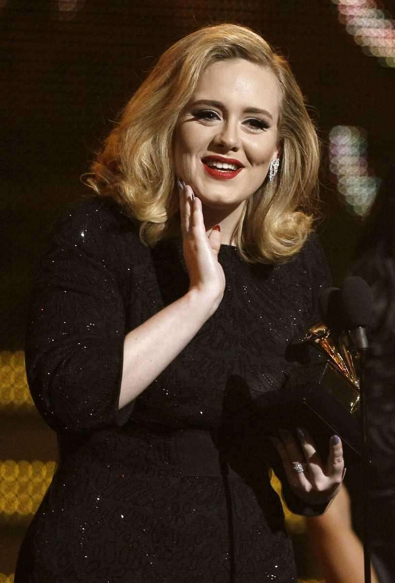 Adele accepts the award for best pop solo