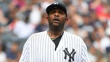 Yankees starting pitcher CC Sabathia stands on the