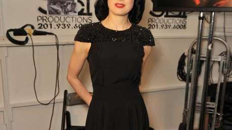Model Dita Von Teese poses backstage at the