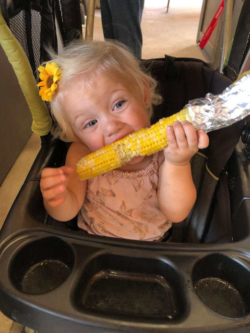 Enjoying some roasted corn at Waterdrinker farm.