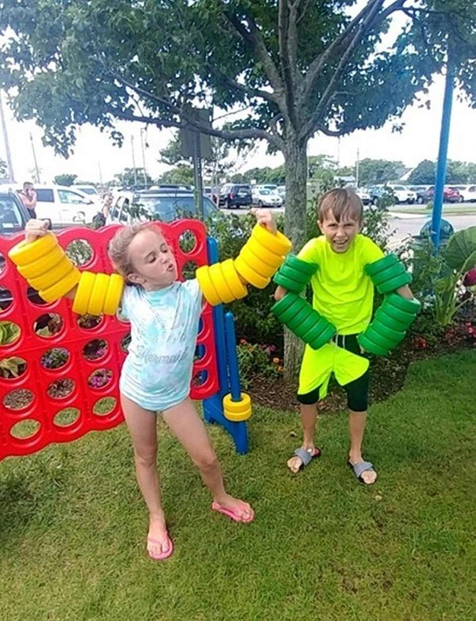 """Kaylee and Lucas showing their """"muscles"""" at their"""