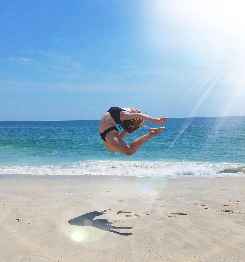 Amilia Borneman leaping down the beach