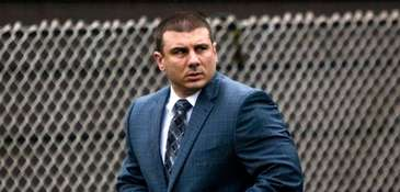 NYPD Officer Daniel Pantaleo leaves his house on
