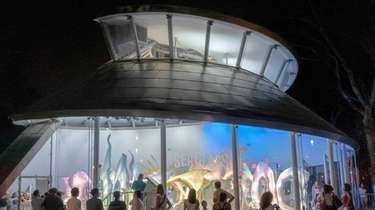 Visitors can ride the SeaGlass Carousel at The