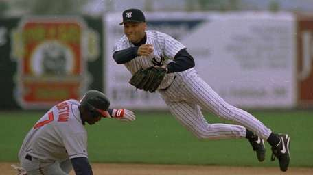 Derek Jeter tries to turn a double play