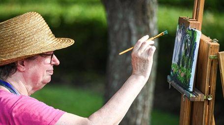 Linda Prentiss of Ronkonkoma works on a canvas
