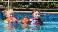 Twins, Billy and Gracie Trudden cooling off in
