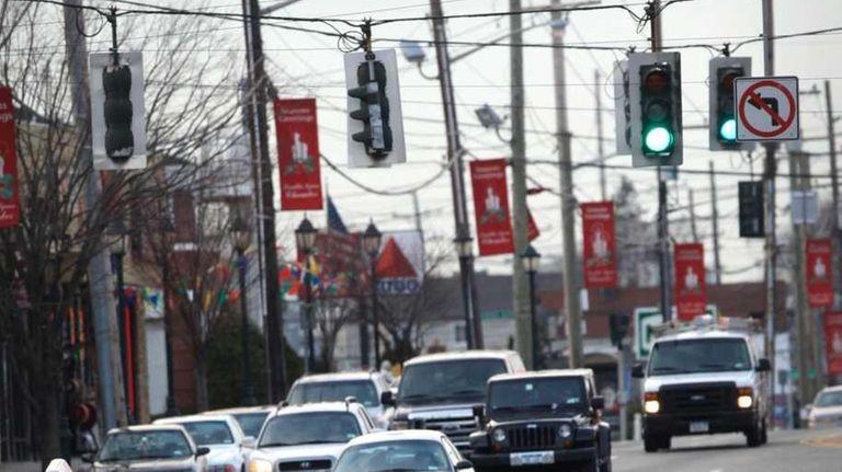 A pedestrian crosses Hempstead Turnpike in Franklin Square