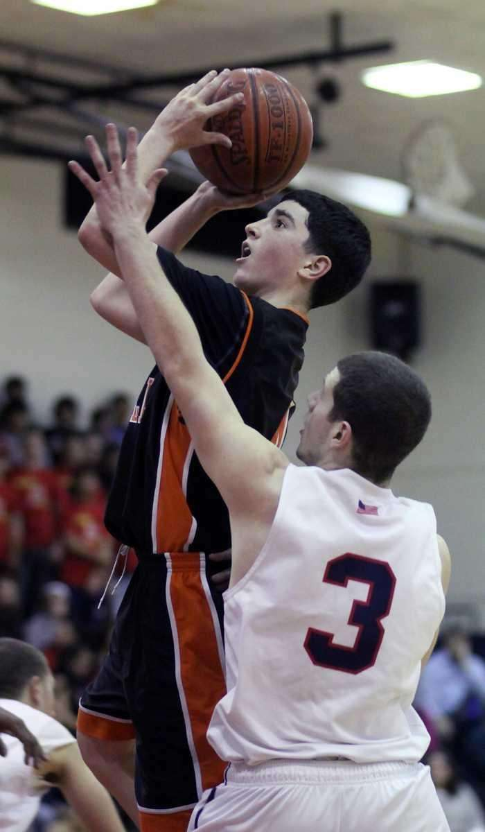 Hicksville's Ryan Mannix hits the jumper for two