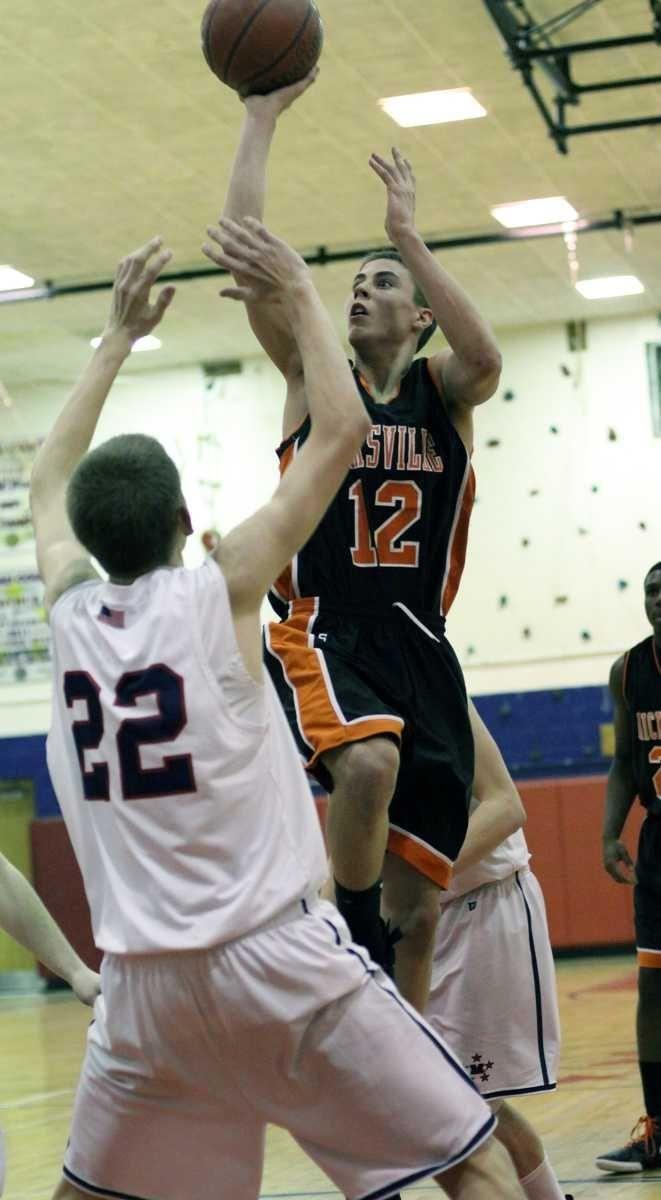 Hicksville's Nicholas Rosenburg tries a shot over Andrew