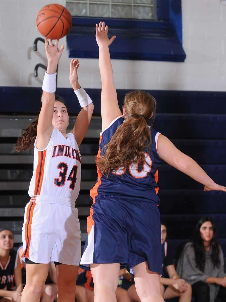 Jacqueline Albanese, left, shoots a jumper over Great