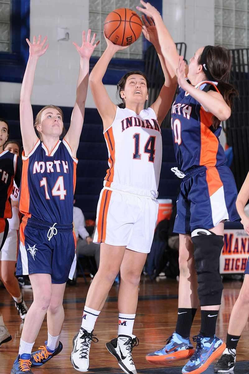 Nicole Kiess, center, tries to drive past Great