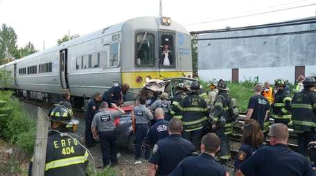 Officials at the scene in East Rockaway Monday