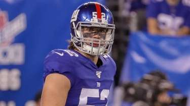 Giants linebacker Jake Carlock looks on during the