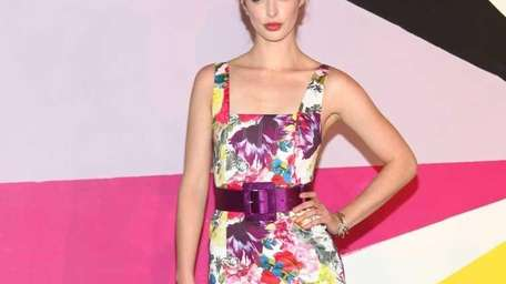 Actress Krysten Ritter poses on the runway at
