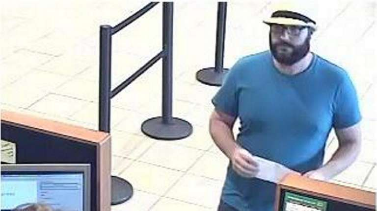 Cops: Fedora-wearing bandit charged for Miller Place bank robbery