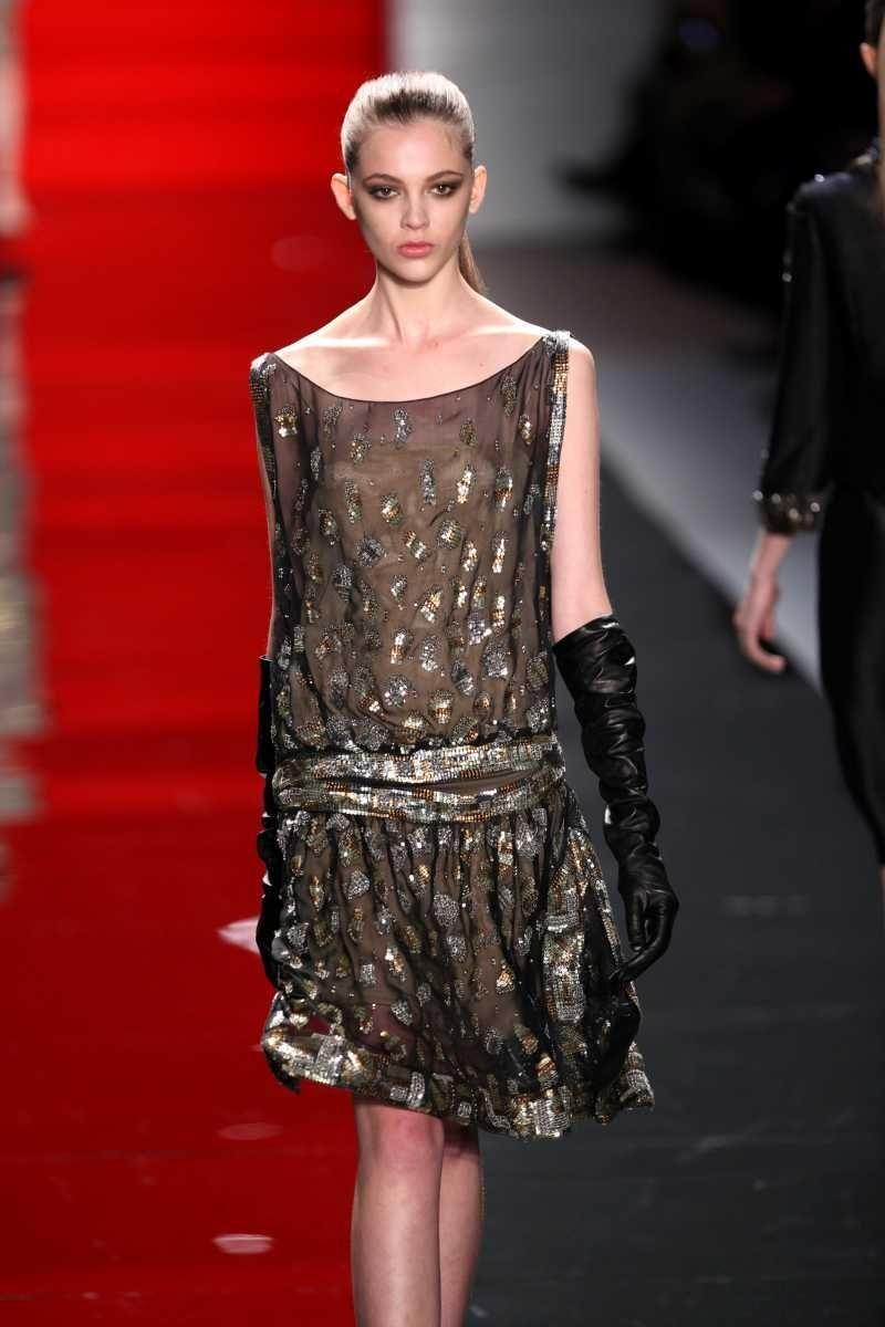 A model walks the runway at the Reem