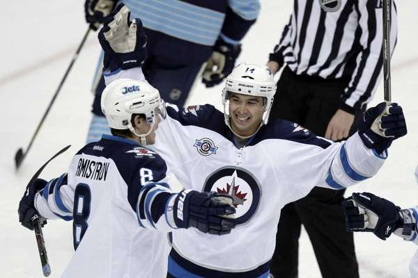 Winnipeg Jets' Alexander Burmistrov (8) celebrates his first-period