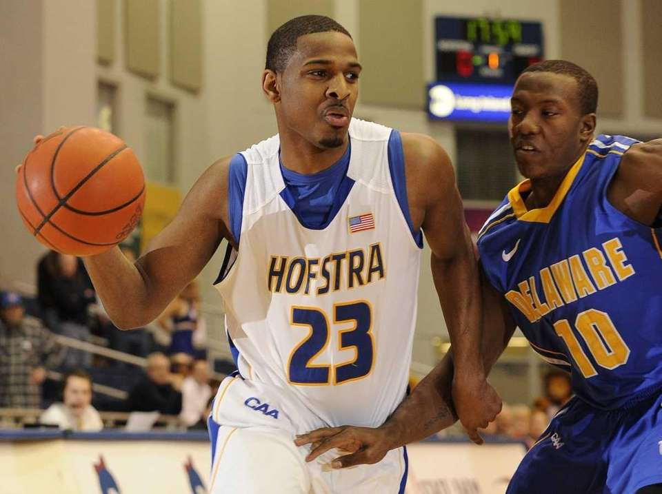 Hofstra guard Mike Moore drives around Delaware guard