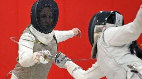 Ward Melville's Demi Antipas during her foil match