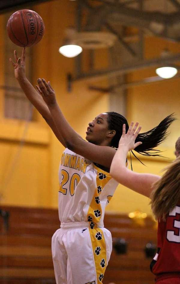 Commack's Chloe Mellon puts up a shot against
